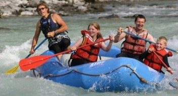 Family whitewater rafting trip on the Athabasca River in Jasper National Park